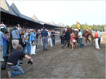 Curlin returns to the winner's circle after the Woodward